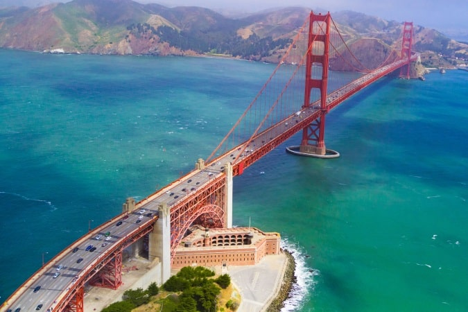 An aerial view of the Golden Gate Bridge in San Francisco on a sunny day
